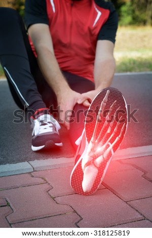 Man runner outside with digital composite of foot bones - stock photo