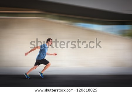 Man Running by Building - stock photo