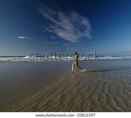 Man running by the seashore in a summer day