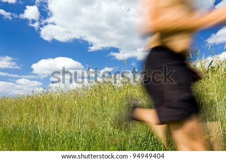 Man running cross country in summer nature, sport and fitness outdoors - stock photo