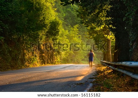 Man running during sunset and after the rain. - stock photo