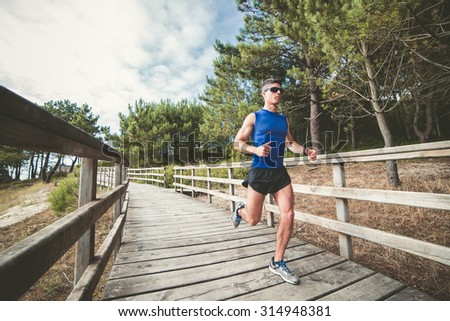 Man running in a promenade in the forest