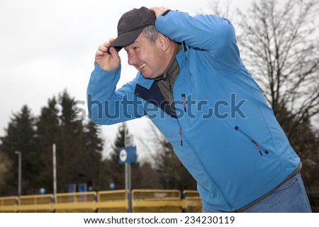 Man running in rainy stormy weather - stock photo