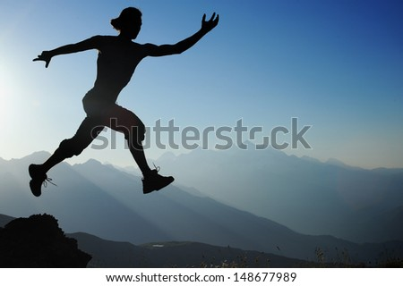 man running in the mountains.