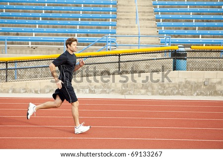 Man running on a track - stock photo