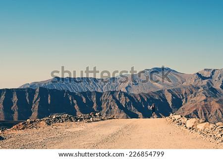 Man Running on Mountain Track - stock photo