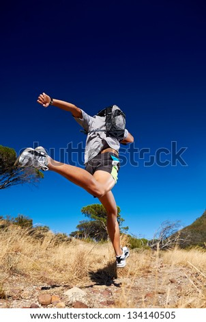 man running with backpack - stock photo