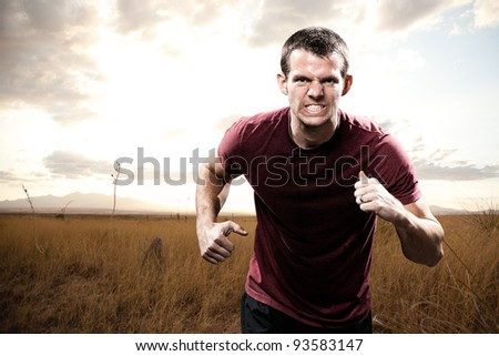 Man Running with Intensity and Determination - stock photo