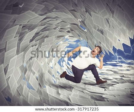Man runs away from wave of sheets - stock photo