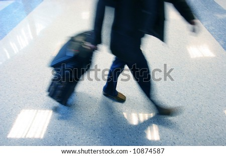 Man rushing in ariport to catch his flight with motion blur - stock photo