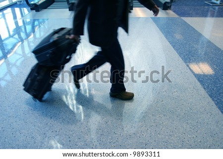 Man rushing to catch his flight in airport - stock photo
