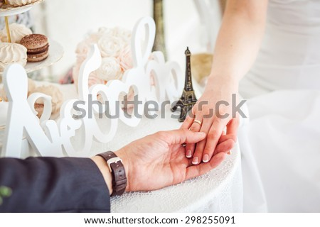 man's and woman's hands on the table in cafe - stock photo