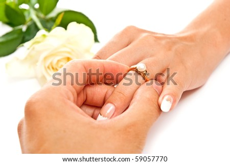 Man's and woman's hands with golden ring. On white - stock photo