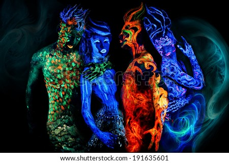 Man's and women's faces and bodies with fluorescent body art. Black background.
