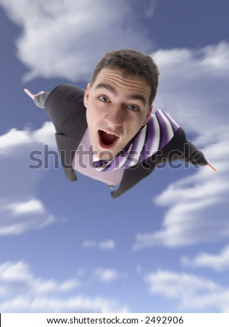 Man's body moving toward on the blue cloudy sky. Focus on the eyes, the rest blured.