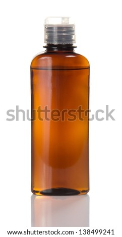 Man's cosmetics for hair in the glass bottle, isolated on white - stock photo