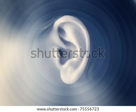 Man's ear with sound waves - stock photo