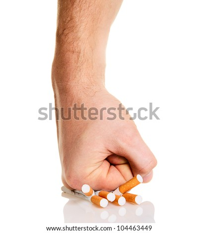 Man's fist crushing cigarettes isolated on white background - stock photo