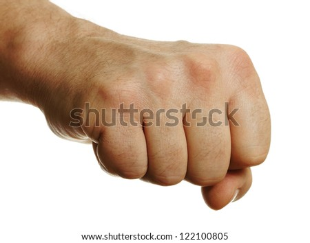 Man`s fist on white surface. - stock photo
