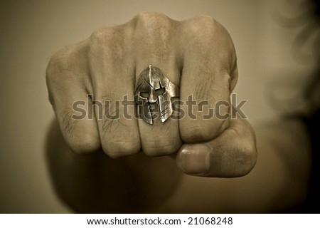 Man's fist with a spartan ring in your finger