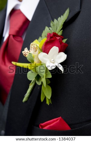 man's floral pin with red tie - stock photo