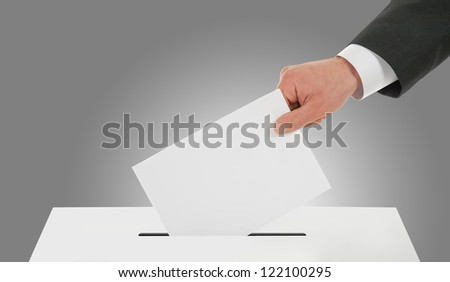 Man's hand down the ballot - stock photo