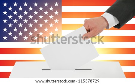 Man's hand down the ballot against the American flag