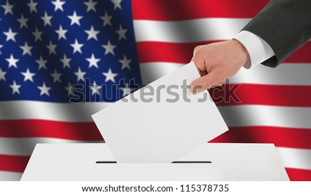 Man's hand down the ballot against the American flag - stock photo