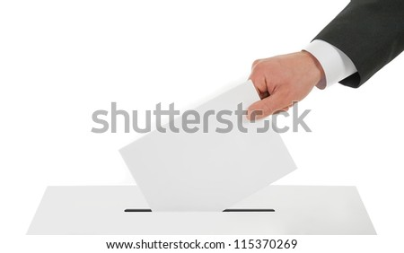 Man's hand down the ballot in the ballot box. Isolated on white