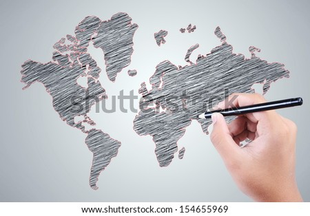 man's hand drawing a world map over the gray background - stock photo