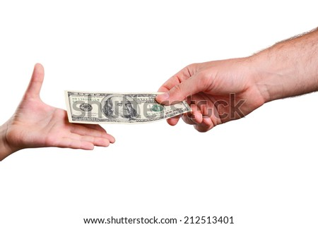 man's hand gives a the bill 100 US dollars in a child's hand. isolated on white background. horizontal