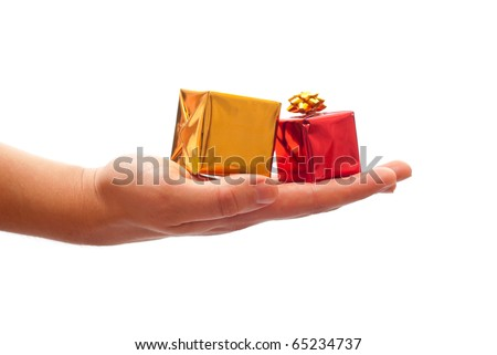 Man's hand giving a christmas gifts. Isolated on white background - stock photo