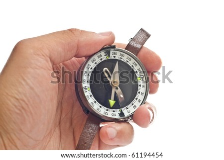 Man's hand holding a compass. Isolated on white - stock photo