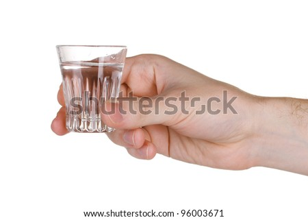 Man's hand holding a glass with vodka isolated on white - stock photo