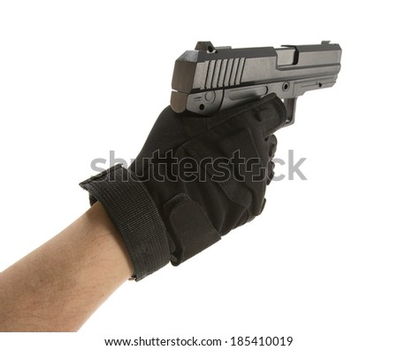 Man's hand holding a pointing gun with a finger on the trigger - stock photo