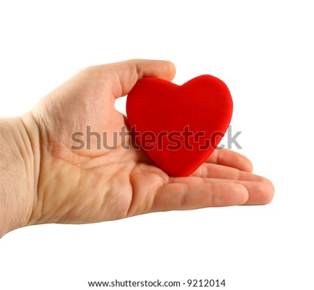 Man's hand holding a red heart in palm