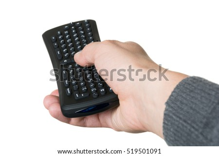 Man's hand holding a remote control. Isolated on white background.