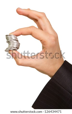 man's hand holding a stack of silver coins on white background