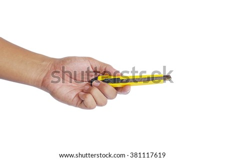 man's hand holding a yellow utility knife. knife in closed, not ready to cut position.