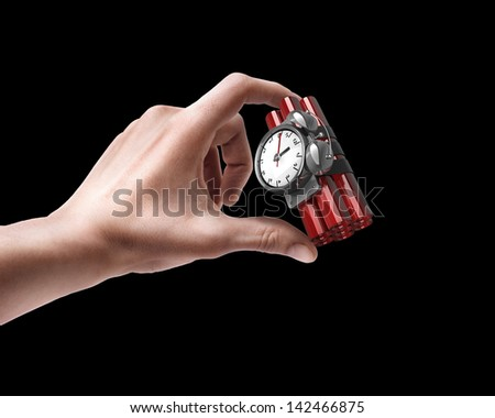 Man's hand holding Bomb with clock timer isolated on black background - stock photo