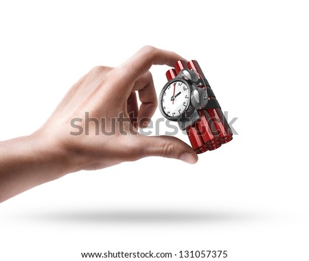 Man's hand holding Bomb with clock timer isolated on white background - stock photo