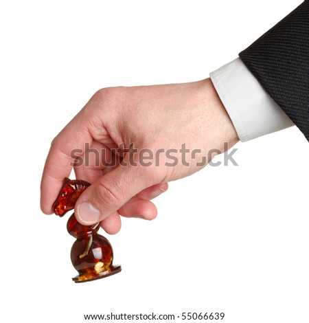 Man's hand holding chess horse isolated on the white background. - stock photo