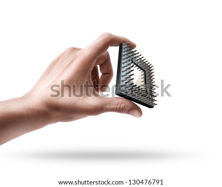 Man's hand holding CPU chip isolated on white background - stock photo