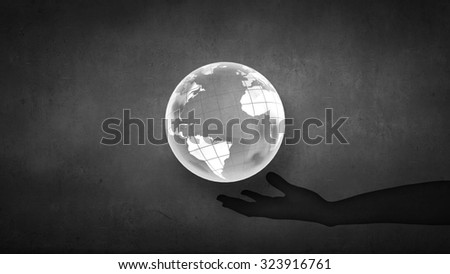 Man's hand holding digital Earth planet representing global technologies concept - stock photo