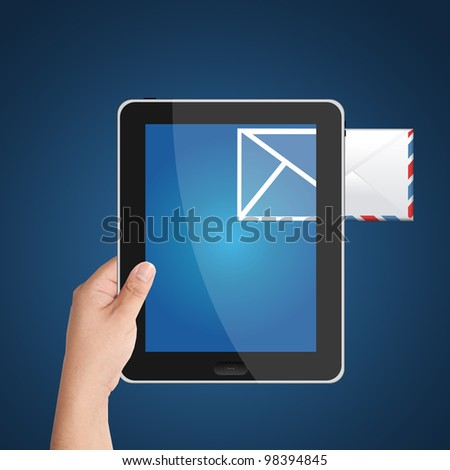 Man's hand holding digital tablet PC with incoming mail icon. Isolated on blue background - stock photo