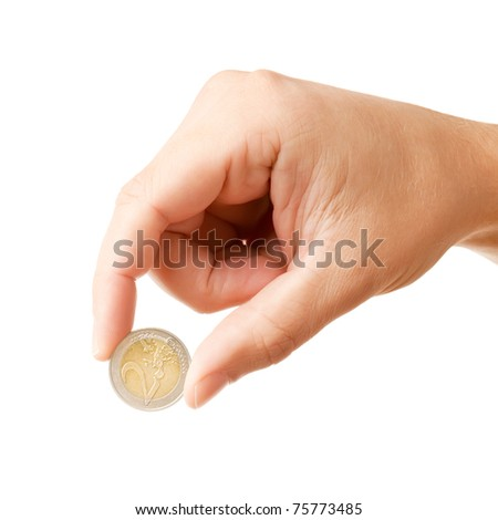 Man's hand, holding 2 Euros coin, isolated on white background - stock photo