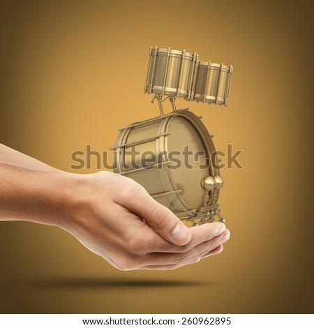 Man's hand holding Golden drum instrument. High resolution 3d render - stock photo