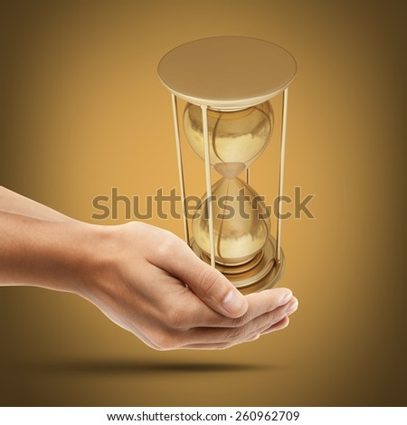 Man's hand holding golden hourglass sand clock. High resolution 3D collection of gold objects