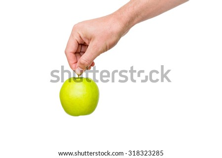 Man's hand holding green apple, isolated on white background - stock photo