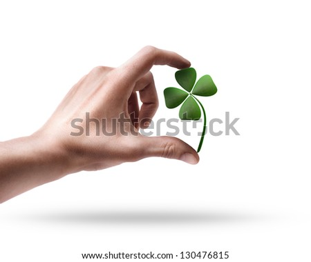 Man's hand holding green clover  isolated on white background - stock photo